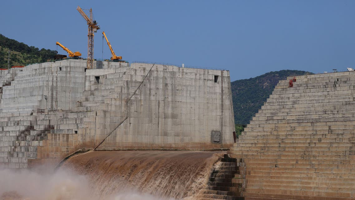 FILE PHOTO: Water flows through Ethiopia's Grand Renaissance Dam as it undergoes construction work on the river Nile in Guba Woreda, Benishangul Gumuz Region, Ethiopia September 26, 2019. Picture taken September 26, 2019. REUTERS/Tiksa Negeri/File Photo