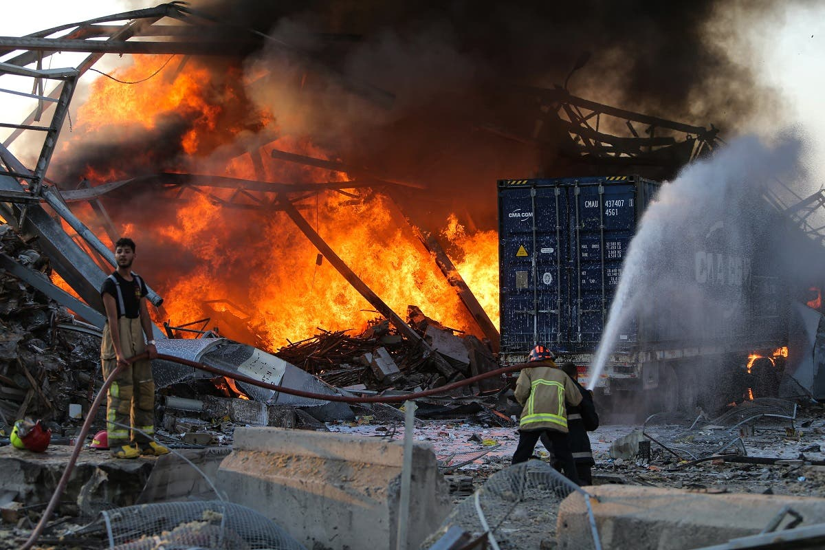 Firefighters douse a blaze at the scene of an explosion at the port of Lebanon's capital Beirut on August 4, 2020. (AFP)