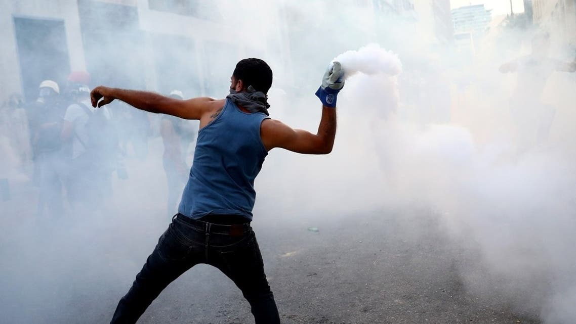 A demonstrator throws a tear gas during a protest following Tuesday's blast in Beirut, Lebanon. (Reuters)