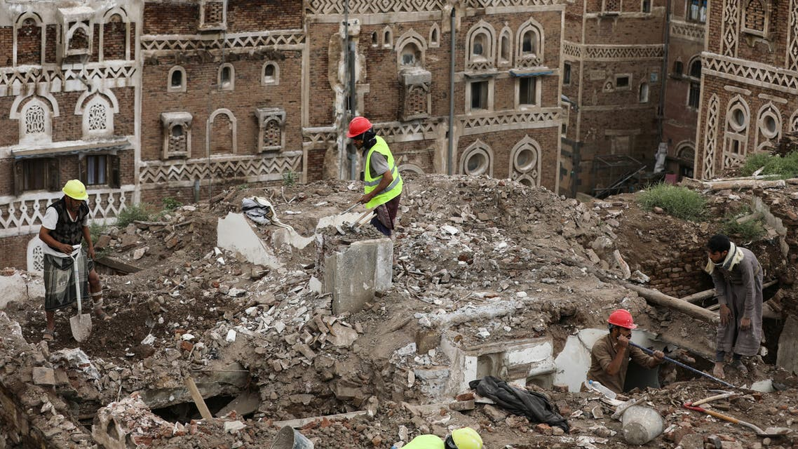 Workers demolish a rain damaged building in the UNESCO World Heritage site of the old city of Sanaa, Yemen August 9, 2020. (Reuters)