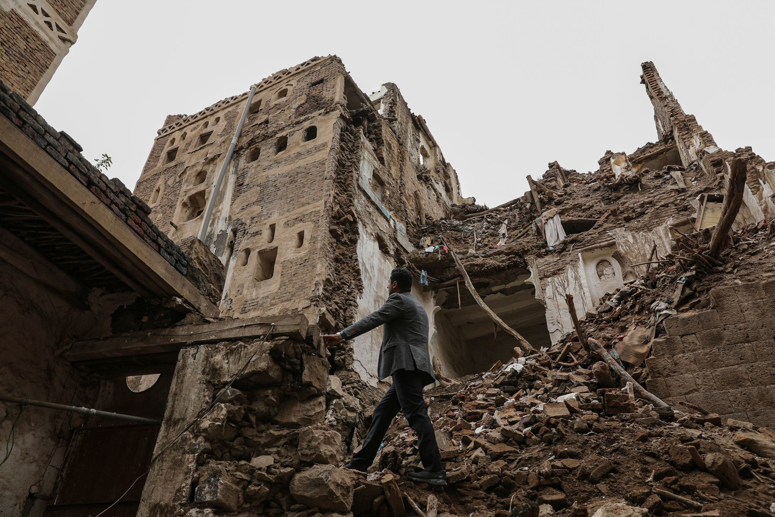 A man walks past a building collapsed by rain in the UNESCO World Heritage site of the old city of Sanaa. (Reuters)20. (Reuters)