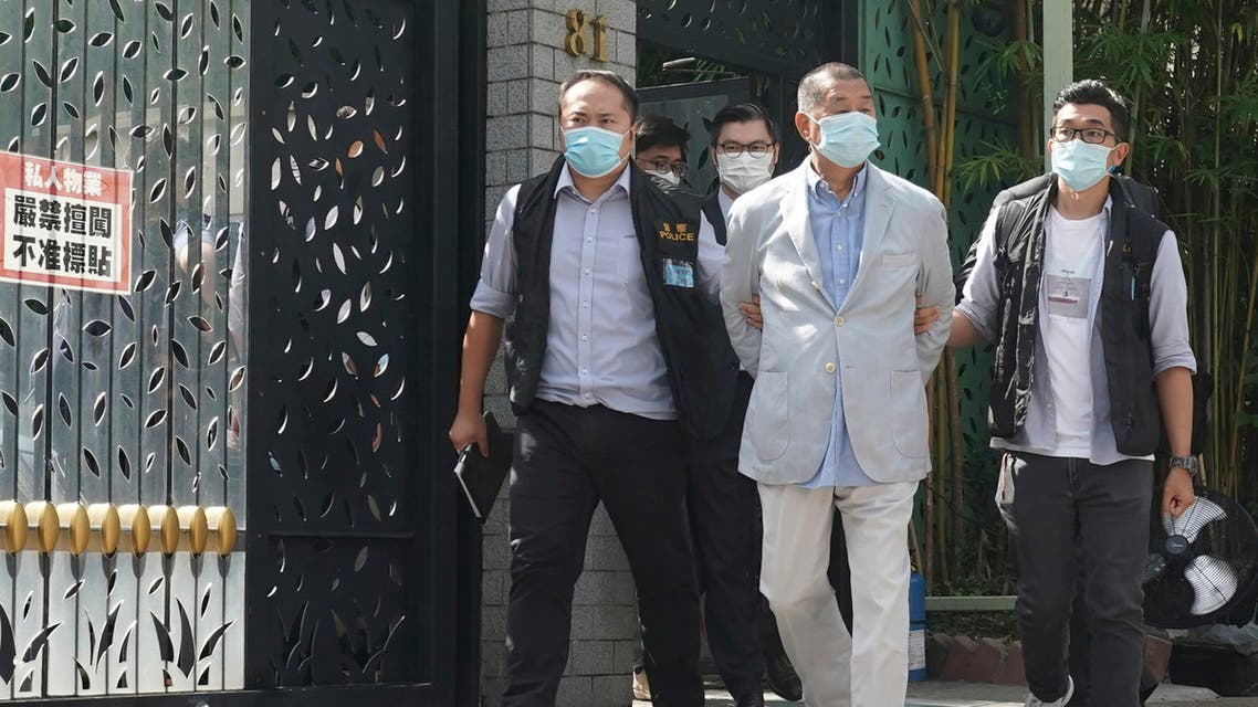 Hong Kong media tycoon Jimmy Lai, center, who founded local newspaper Apple Daily, is arrested by police officers at his home in Hong Kong, Monday, Aug. 10, 2020. (AP)