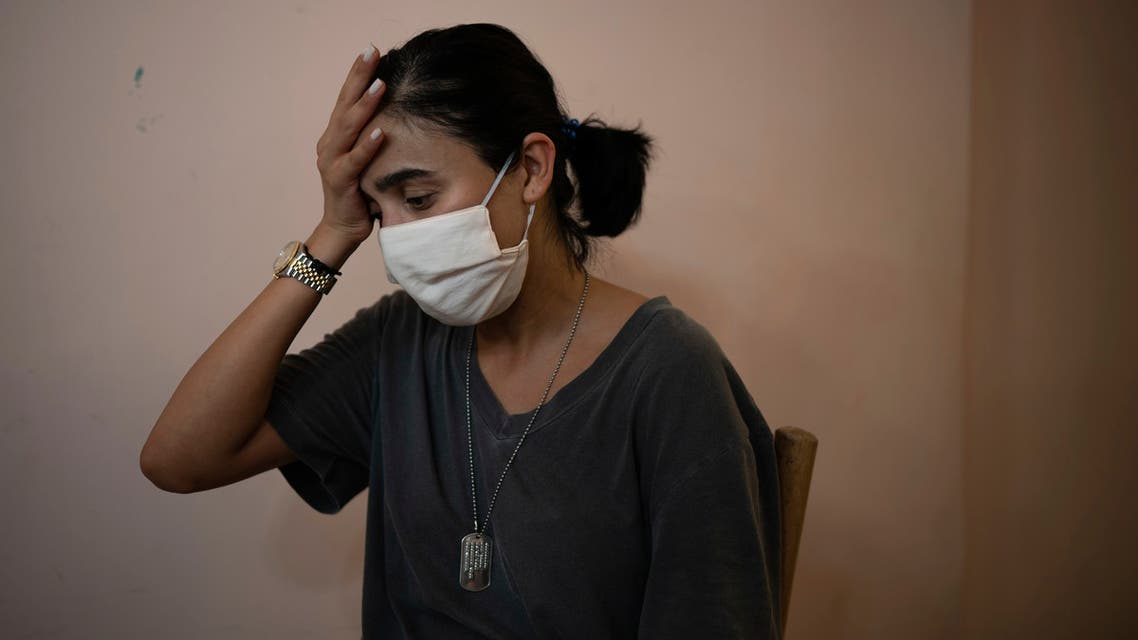 Rachelle Boumelhem reacts during an interview in her damaged beauty salon in Beirut on Aug. 10, 2020. (AP)