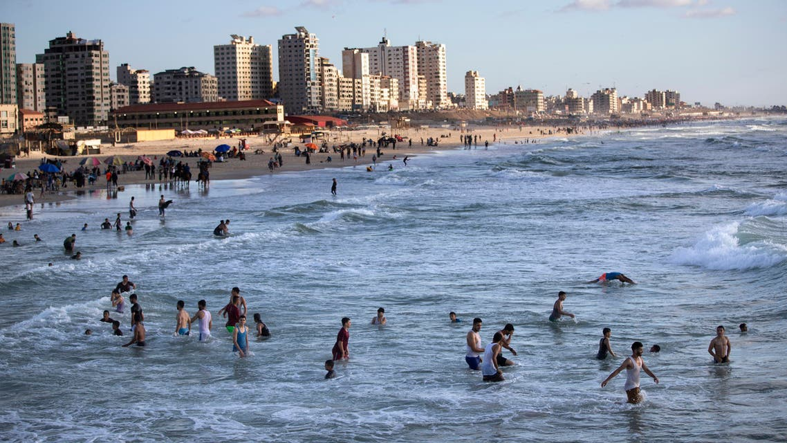 Palestinians enjoy swimming on the beach during a sunny day in Gaza City on May 29, 2020. (AP)