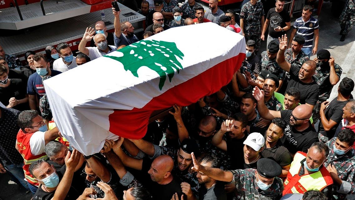 Firefighters carry the coffin of their comrade Rami Kaaki, one of ten firefighters who were killed during the explosion that hit the seaport of Beirut. (AP)