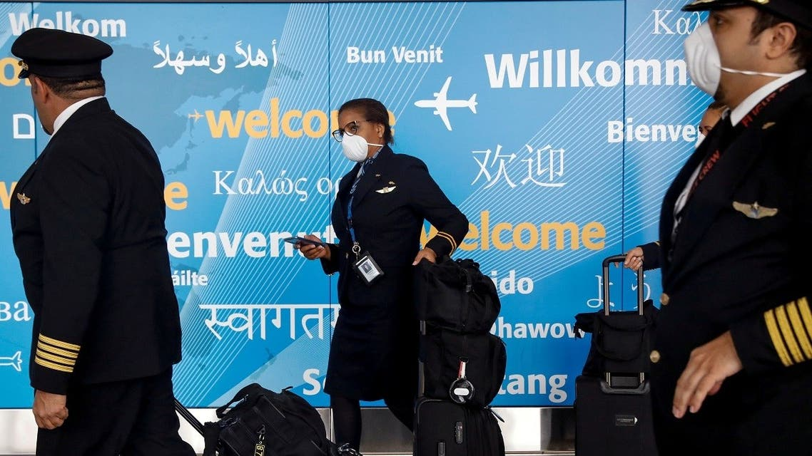 Members of a flight crew wear face masks as they arrive at John F. Kennedy International Airport in New York. (Reuters)