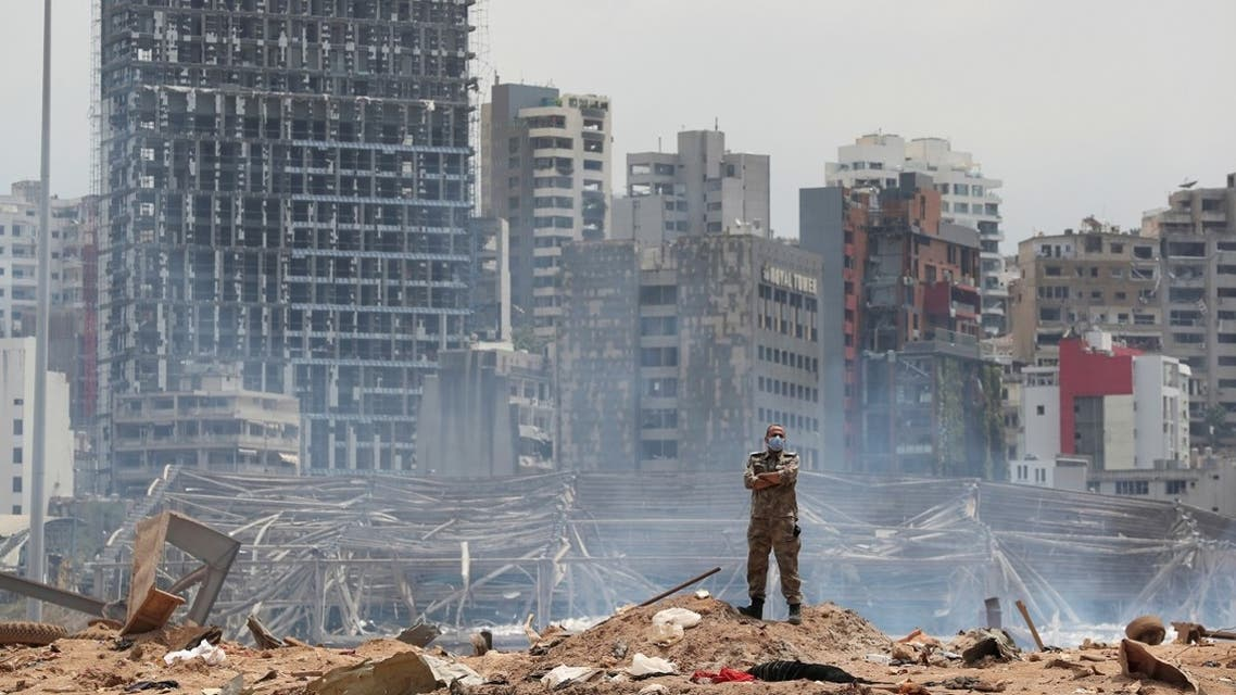 A soldier stands at the devastated site of the explosion at the port of Beirut, Lebanon August 6, 2020. (Reuters)