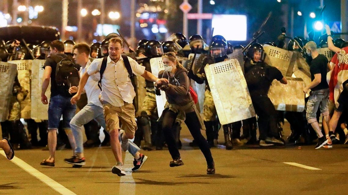 Demonstrators run away from police as they gather to protest against a result of the Belarusian presidential election in Minsk, Belarus, Aug. 9, 2020. (AP)