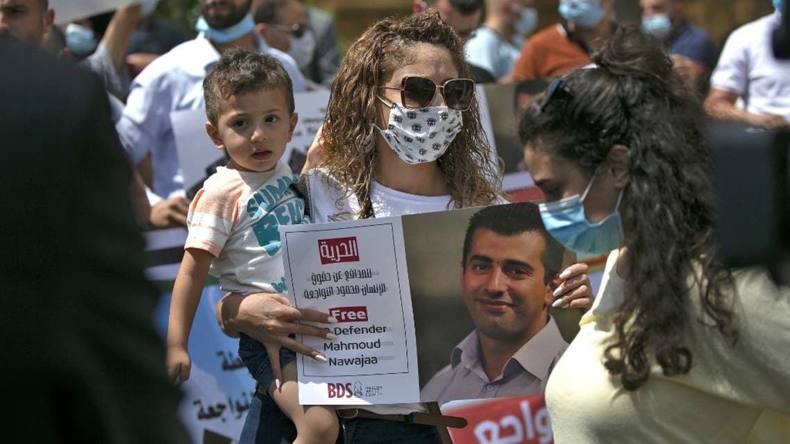 Palestinians protest against the detention by Israel of Boycott, Divestment, Sanctions (BDS) movement campaigner Mahmoud Nawajaa on August 11, 2020 in Ramallah. (AFP)