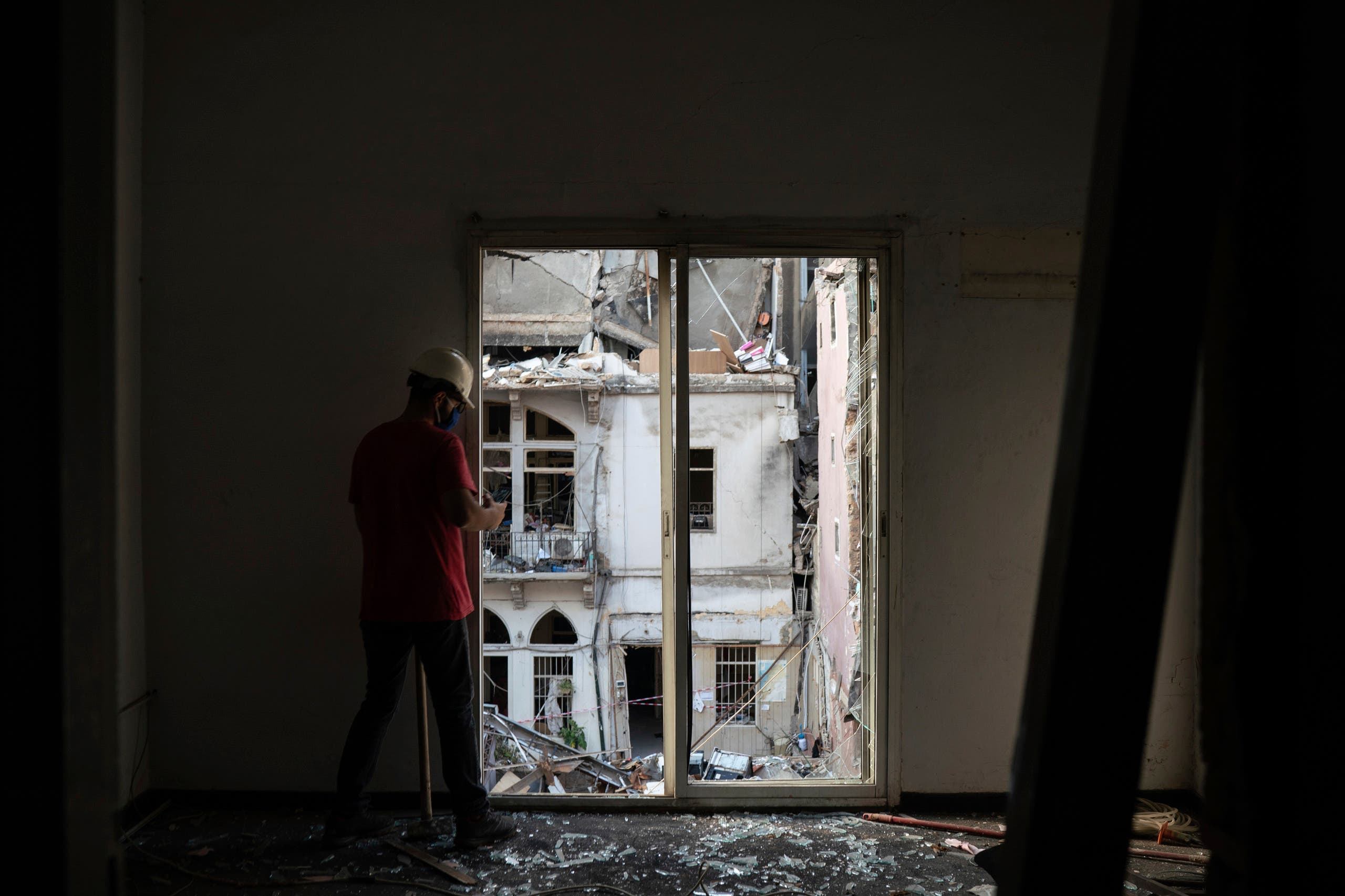 An engineer inspects a residential building heavily damaged in last week's explosion that hit the seaport of Beirut on Aug. 11, 2020. (AP)