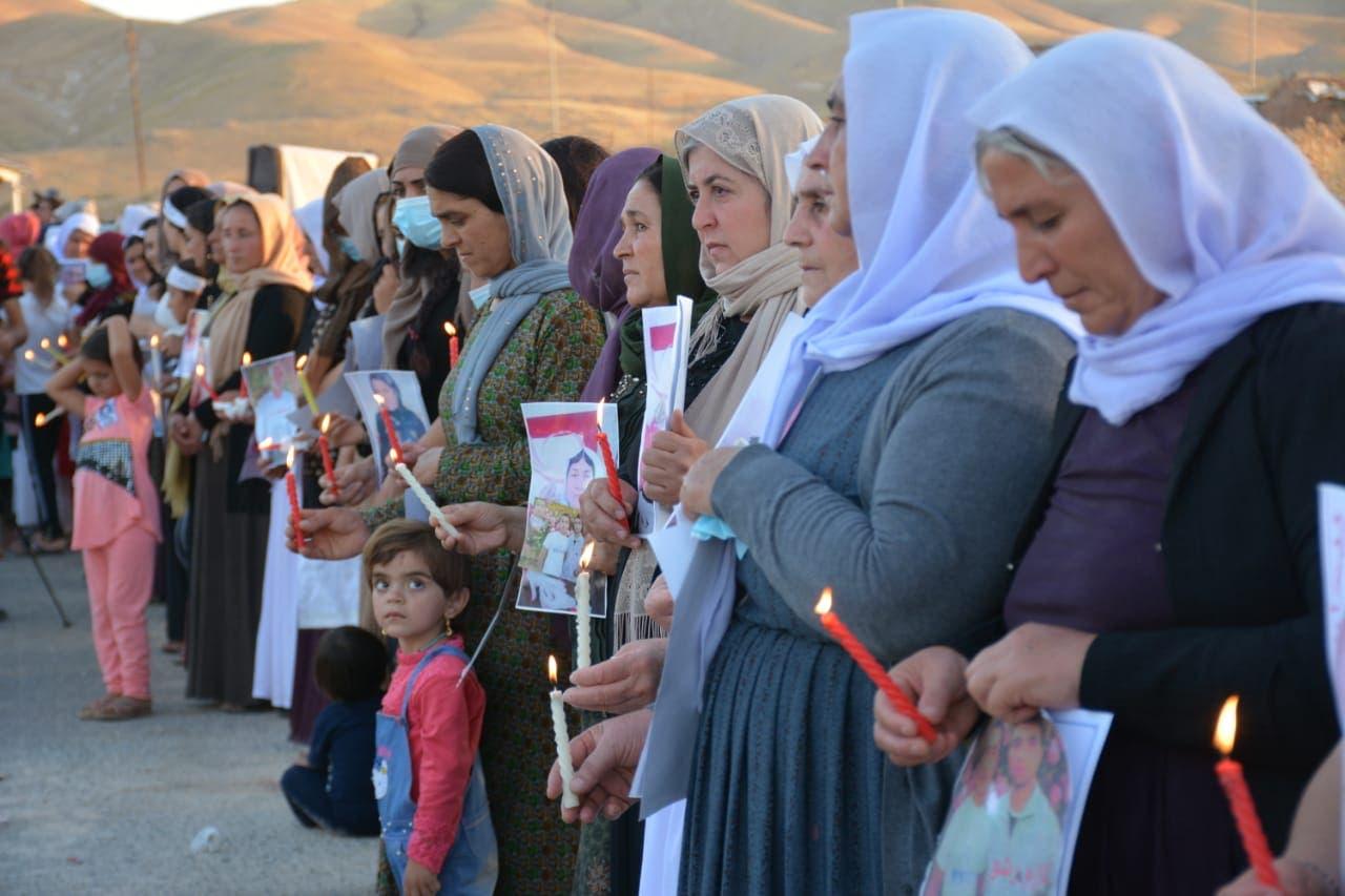 Yazidi women commemorate the ISIS attacks on their community. (Naji Khadida)