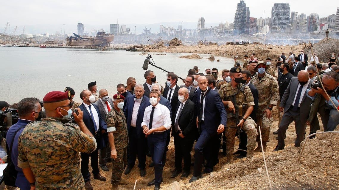 French President Emmanuel Macron and his Foreign Affairs Minister Jean-Yves Le Drian visit the site of the explosion at the Port of Beirut, Aug. 6, 2020. (AFP)