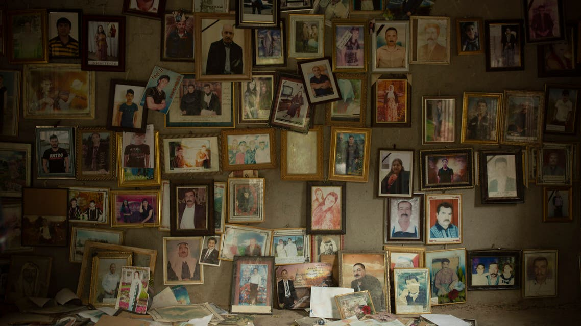 In this Sept. 12, 2019 photo, pictures of Yazidis slain in 2014 by ISIS militants are found in a small room at the Lalish shrine in northern Iraq. (AP)