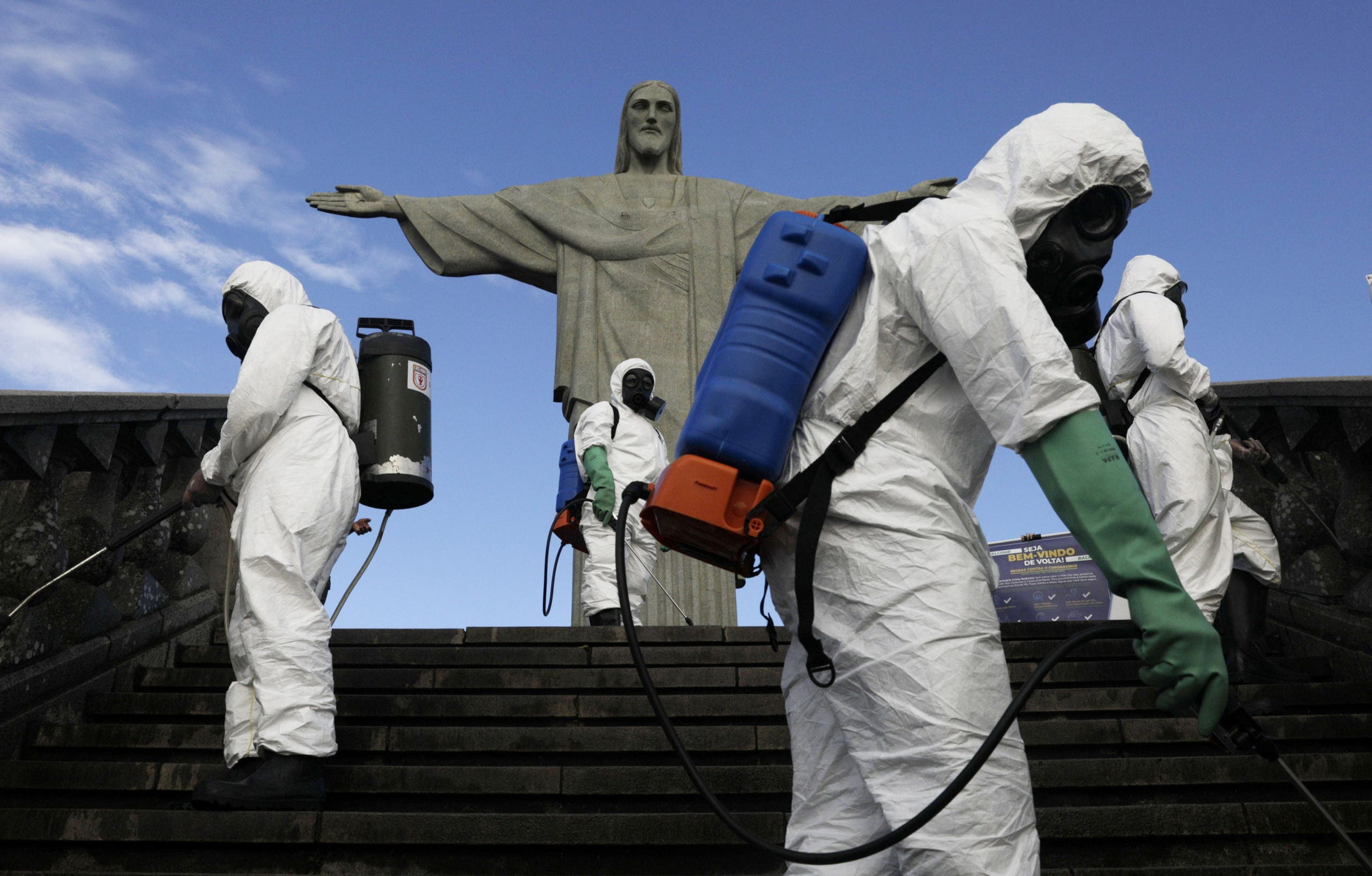 Military members work on disinfection of the Christ the Redeemer statue ahead of its re-opening in Rio de Janeiro, Brazil, August 13, 2020. (Reuters)