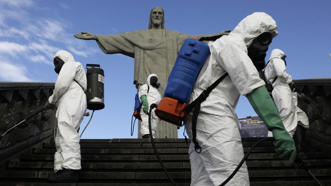 Military members work on disinfection of the Christ the Redeemer statue ahead of its re-opening amid the coronavirus disease (COVID-19) outbreak, in Rio de Janeiro, Brazil, August 13, 2020. REUTERS/Ricardo Moraes