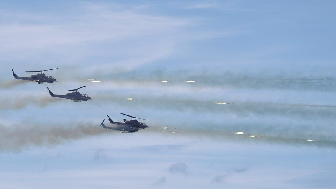 AH-64 Apache helicopters fire during the live fire Han Kuang military exercise, which simulates China's People's Liberation Army (PLA) invading the island, in Pingtung. (Reuters)