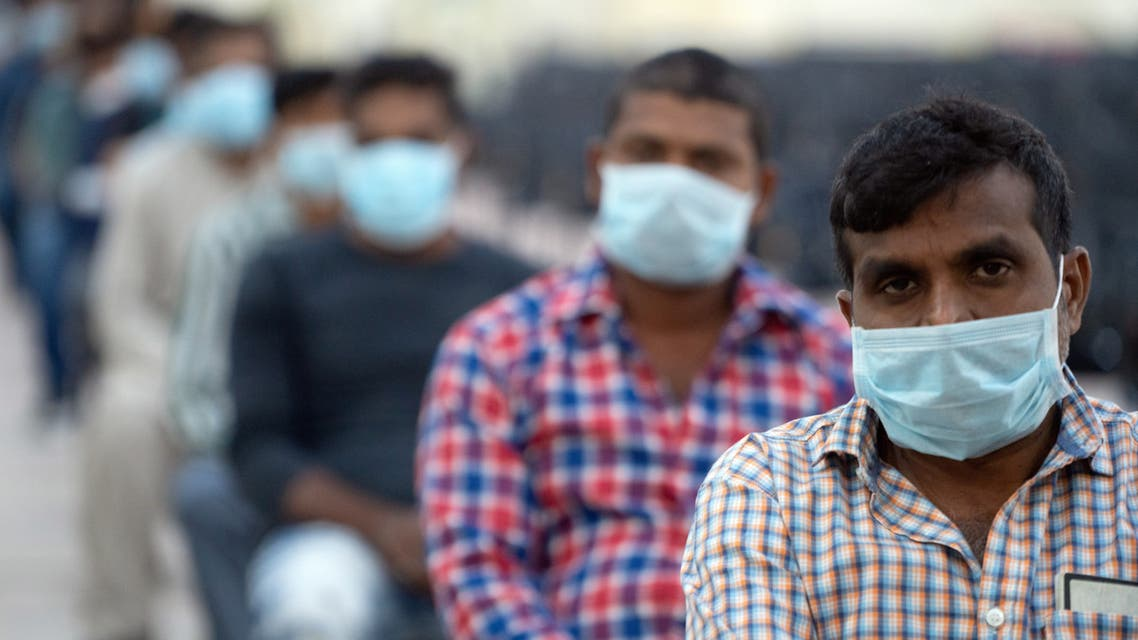 Expatriates wait their turn to be tested at a coronavirus testing centre at Kuwait International Fairgrounds in Mishref. (Reuters)