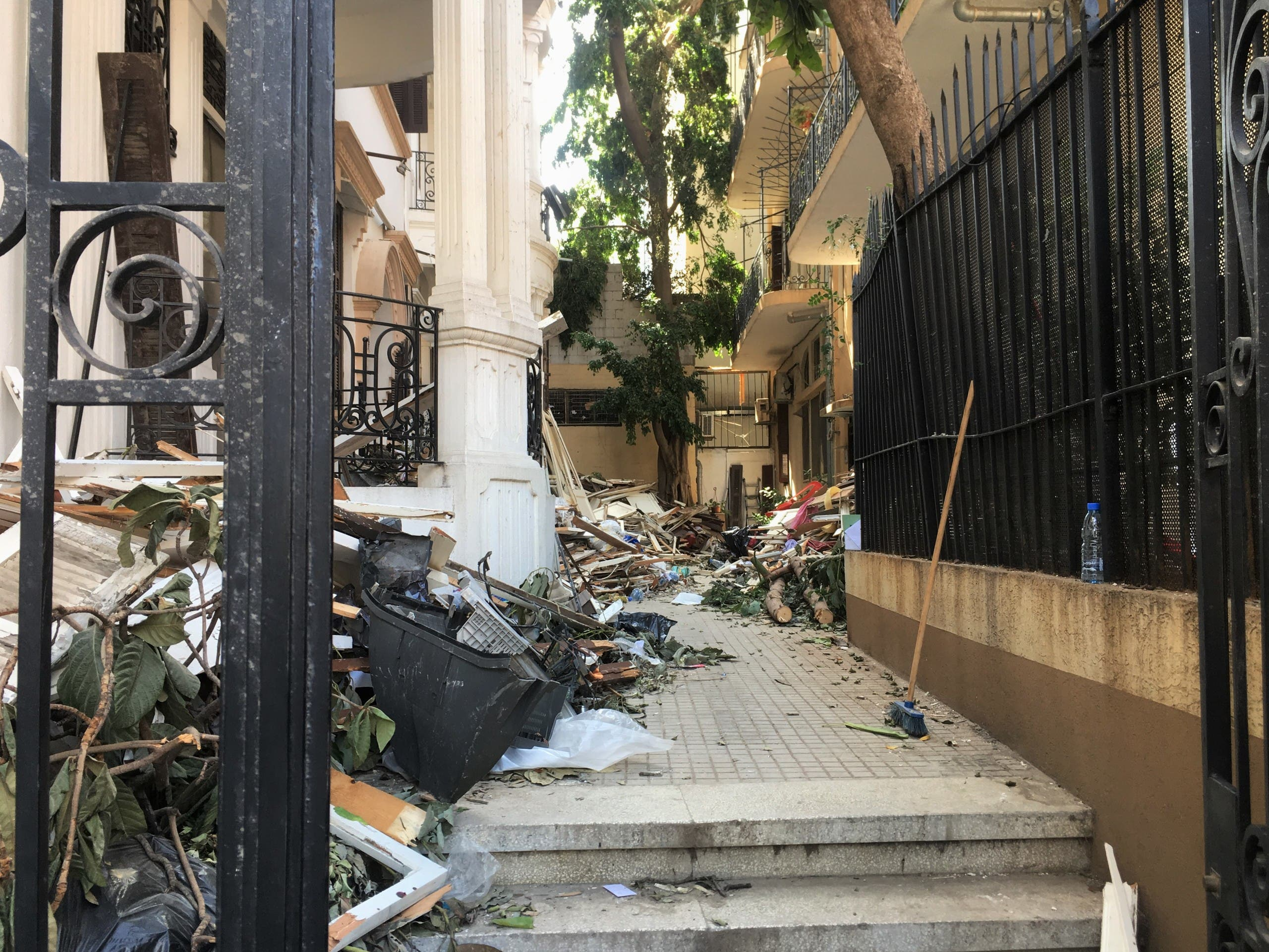 A view of the entrance to the building housing Art on 56th. Debris covers the walkway. (Maghie Ghali)