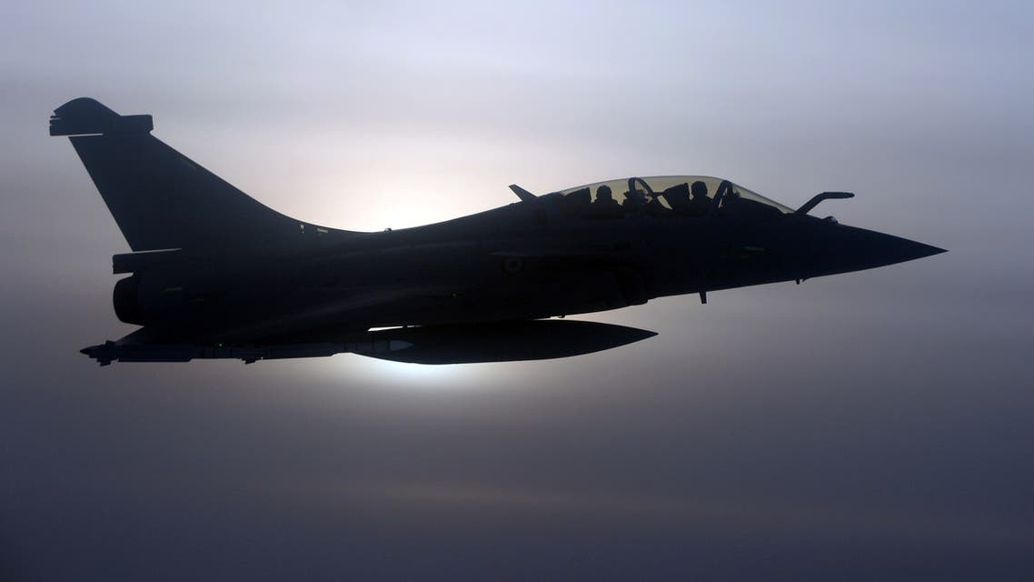 A French Rafale fighter jet demonstrates the interception of a Belgian air force transport plane as they fly over France, January 14, 2020 as part of NATO drills to deter Russian planes from entering allied airspace. Picture taken January 14, 2020. REUTERS/Johanna Geron