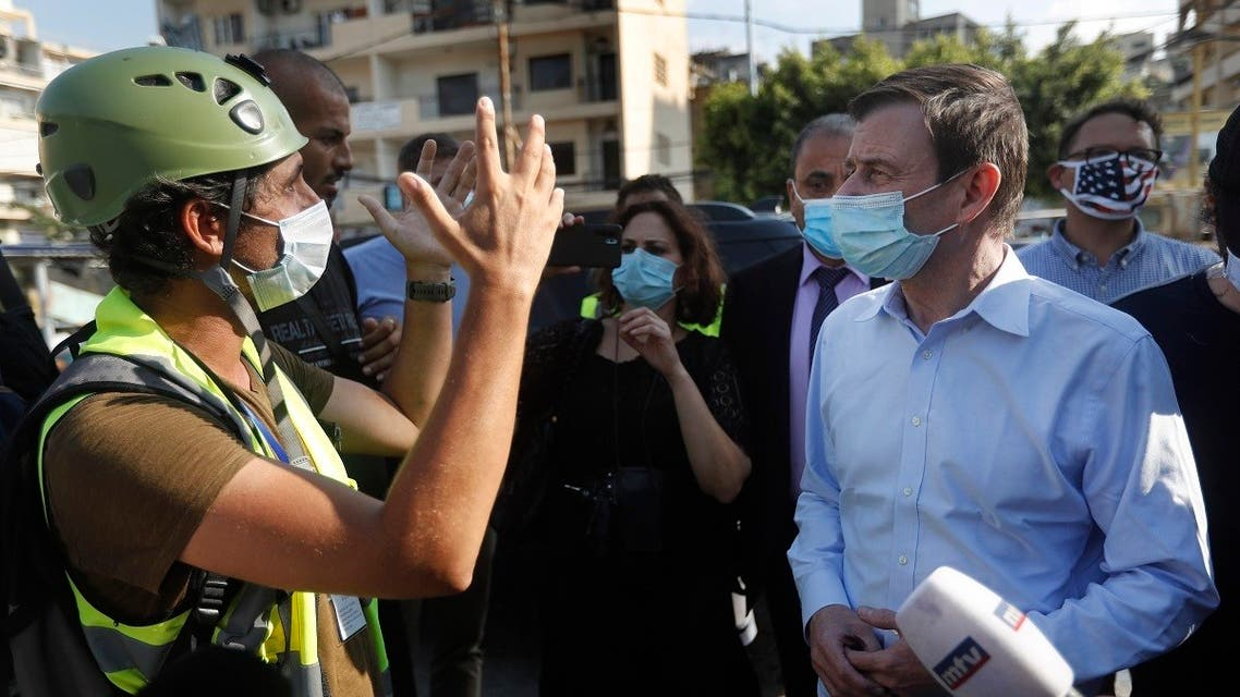 US Undersecretary of State for Political Affairs David Hale listens to an NGO volunteer during his visit to Beirut, Lebanon, Aug. 13, 2020. (AP)