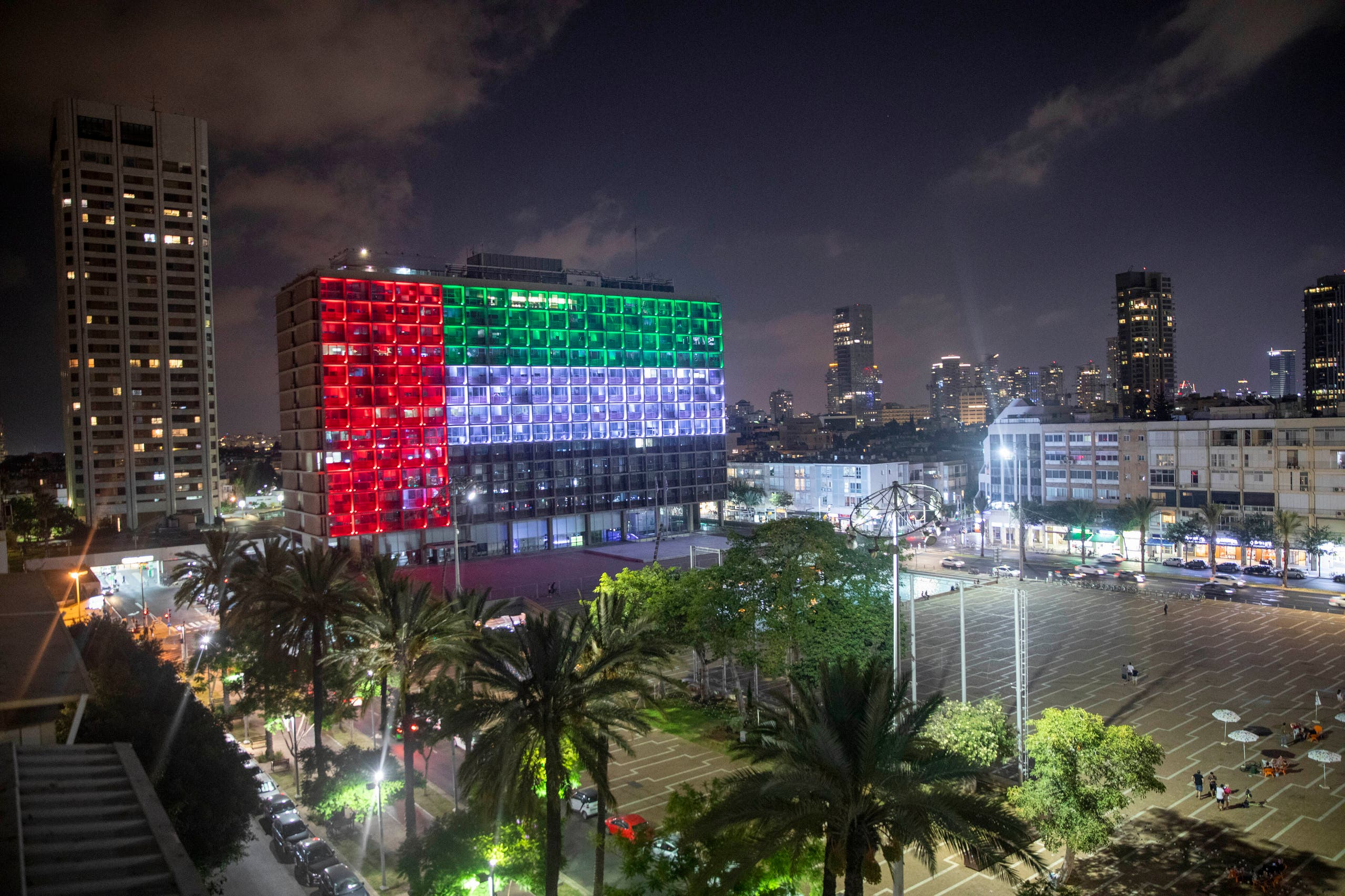 Tel Aviv City Hall is lit up with the flags of the United Arab Emirates and Israel as the countries announced they would be establishing full diplomatic ties, in Tel Aviv, Israel, Thursday, Aug. 13, 2020. (AP)