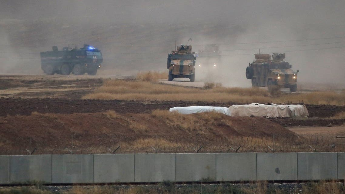Turkish and Russian military vehicles return following a joint patrol in northeast Syria, as they are pictured from near the Turkish border town of Kiziltepe in Mardin province, Turkey, November 1, 2019. REUTERS