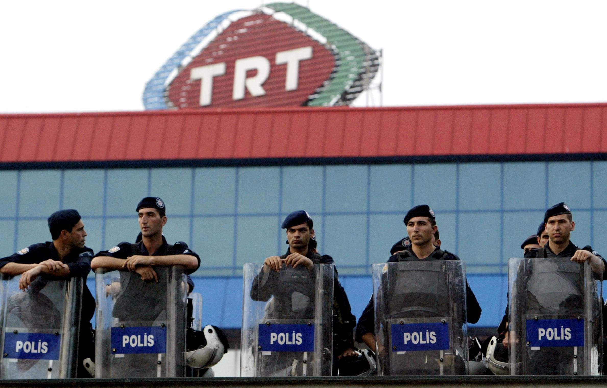 Turkish riot policemen stands guard as part of security measures in front of TRT (Turkish Radio Television Association) during a demonstration. (File photo: AFP)