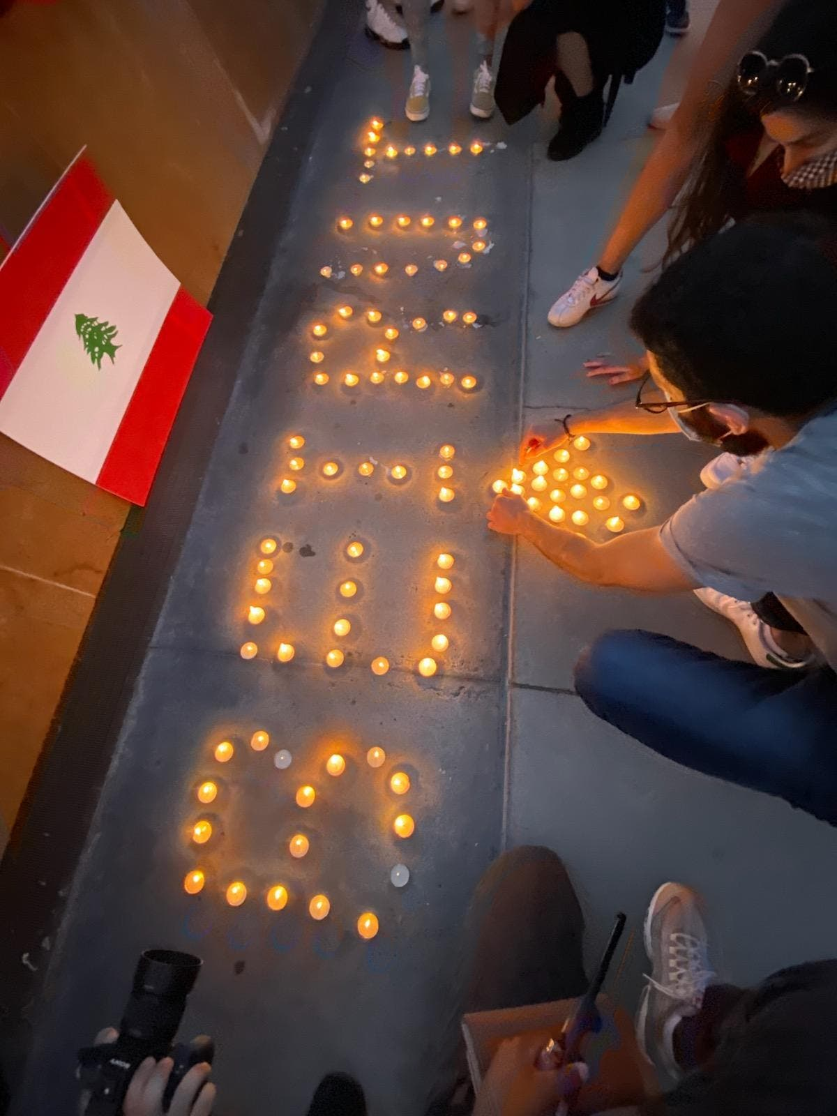 A candlelight vigil held outside San Jose City Hall in San Jose, California, honor of the victims of the Beirut explosion, August 8. (Albert Karam)