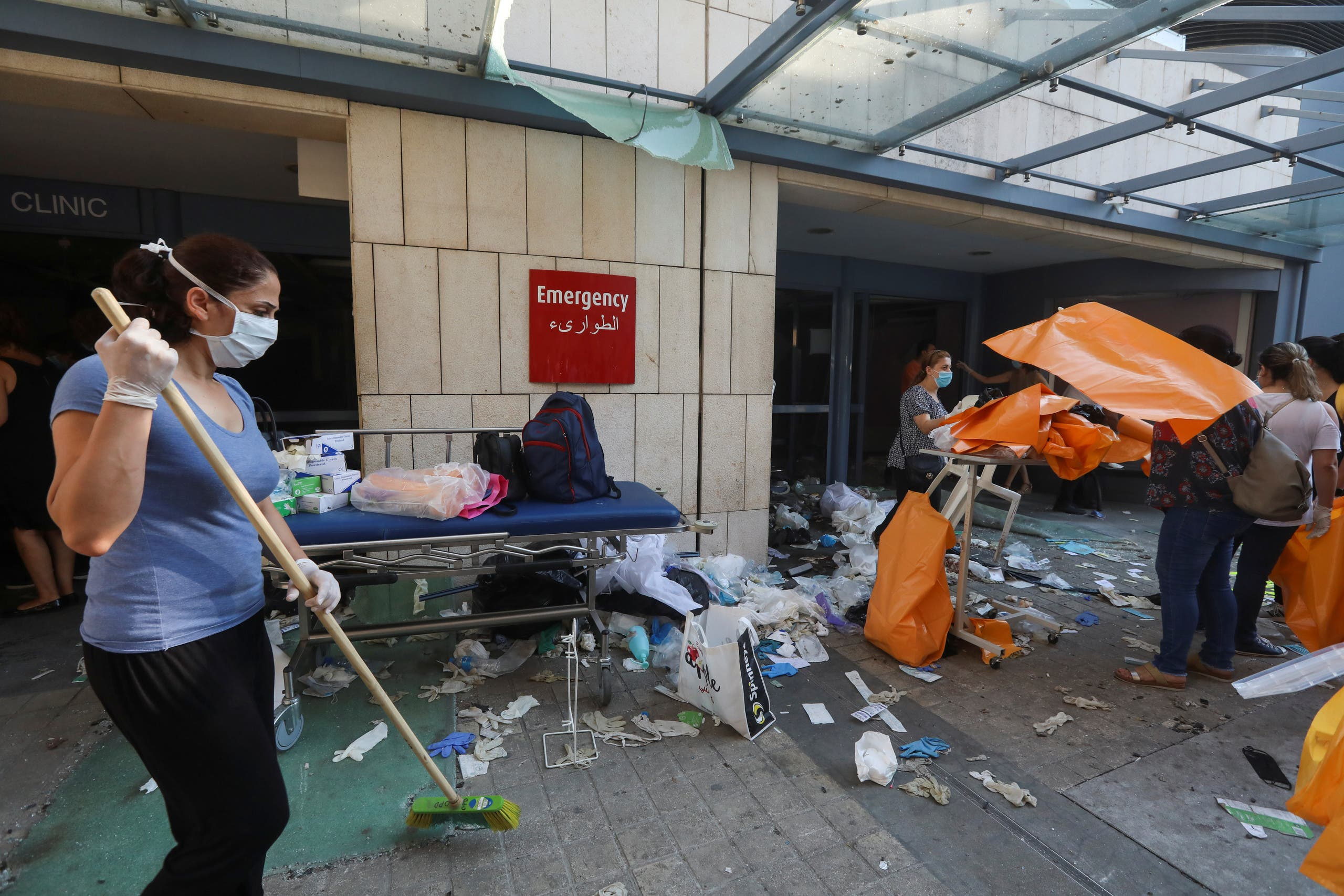 A woman sweeps at a damaged hospital following Tuesday's blast, in Beirut Lebanon August 5, 2020. (Reuters)