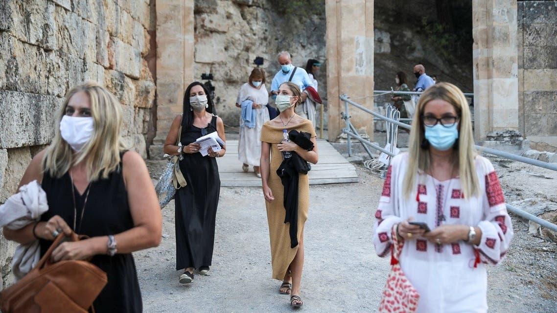 People wearing protective face masks enter the ancient amphitheater of Epidaurus in Epidaurus, Greece, July 24, 2020. (Reuters)