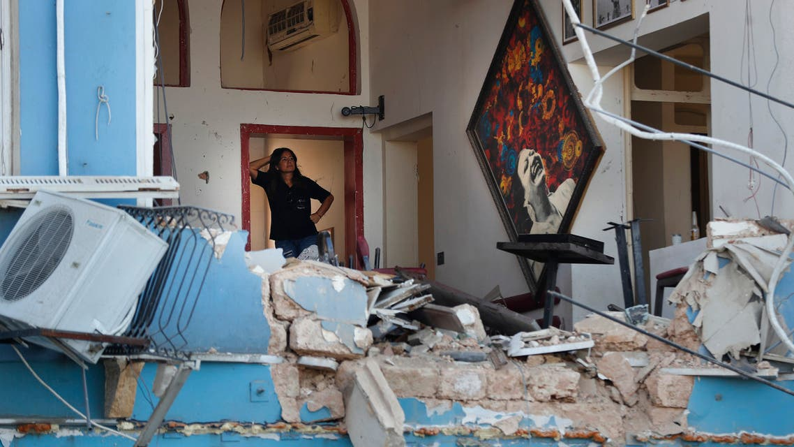 A woman stands inside a damaged restaurant a day after an explosion hit the seaport of Beirut, Lebanon, Wednesday, Aug. 5, 2020. (AP)
