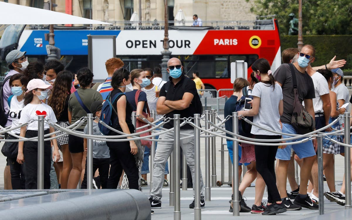 Visitors wearing protective face masks queue to enter the Louvre Pyramid in Paris, as France reinforces mask-wearing as part of efforts to curb a resurgence of the coronavirus disease (COVID-19) across the country, France, August 13, 2020. (Reuters)