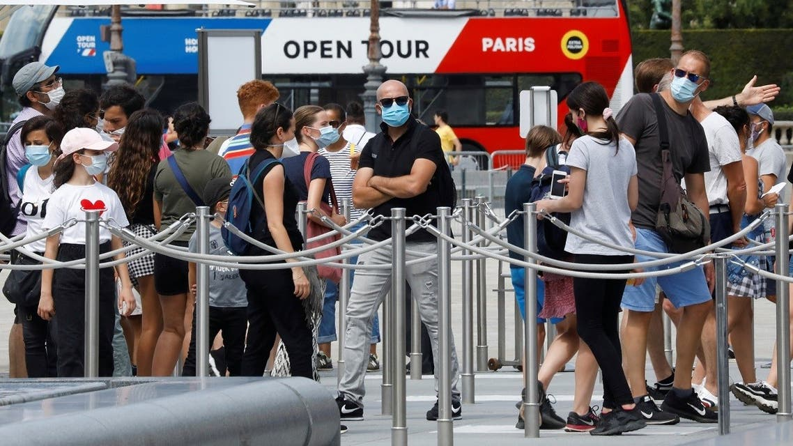 Visitors wearing protective face masks queue to enter the Louvre Pyramid in Paris, as France reinforces mask-wearing as part of efforts to curb a resurgence of the coronavirus disease (COVID-19) across the country, France, August 13, 2020. REUTERS