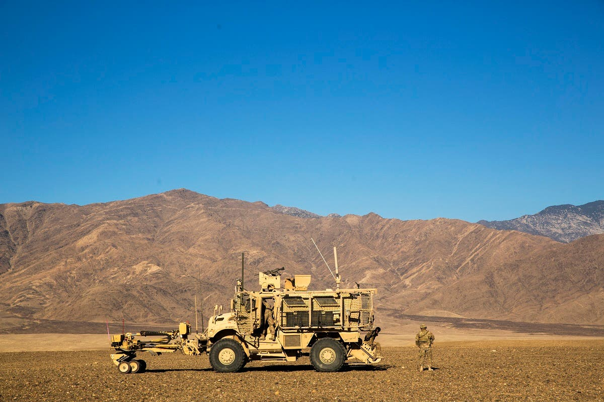 A US soldier from Dragon Company of the 3rd Cavalry Regiment stands outside of an MRAP vehicle near forward operating base Gamberi in the Laghman province of Afghanistan. (Reuters)