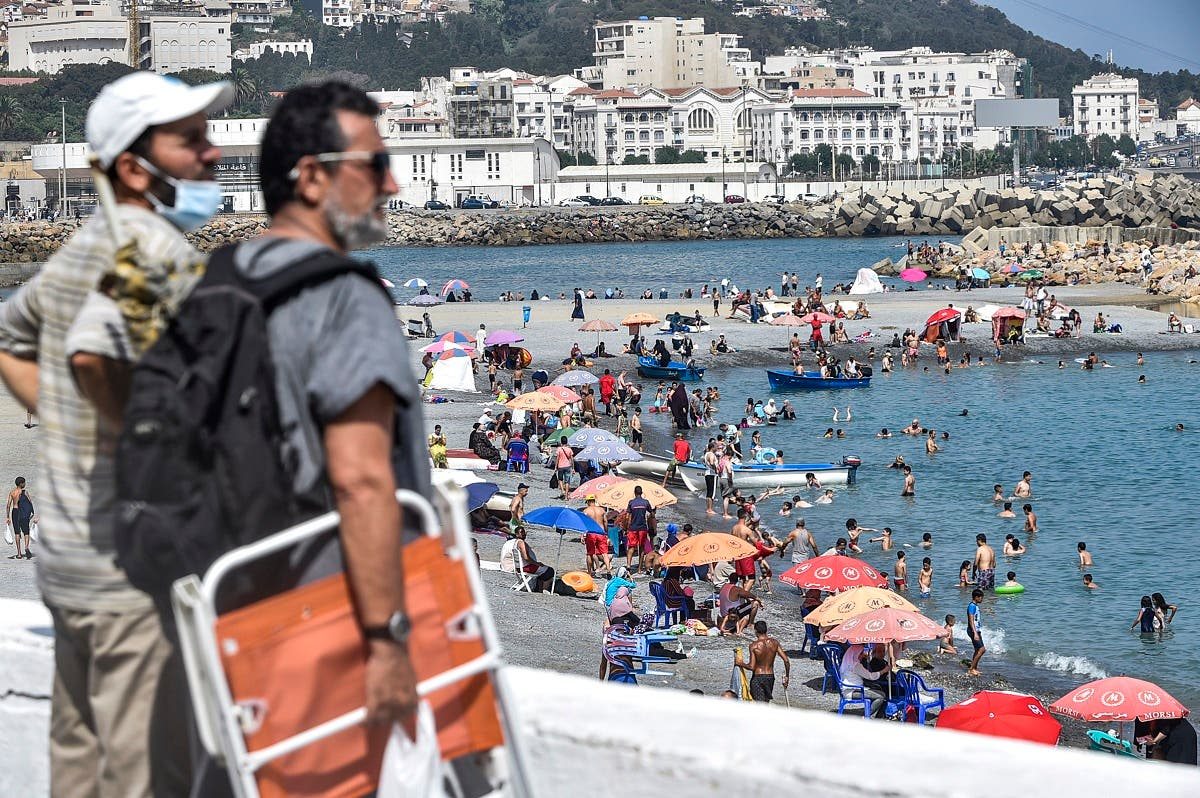 Beachgoers enjoy el-Kettani beach in the Bab el-Oued suburb of Algeria's capital Algiers after its reopening, August 15, 2020. (AFP)