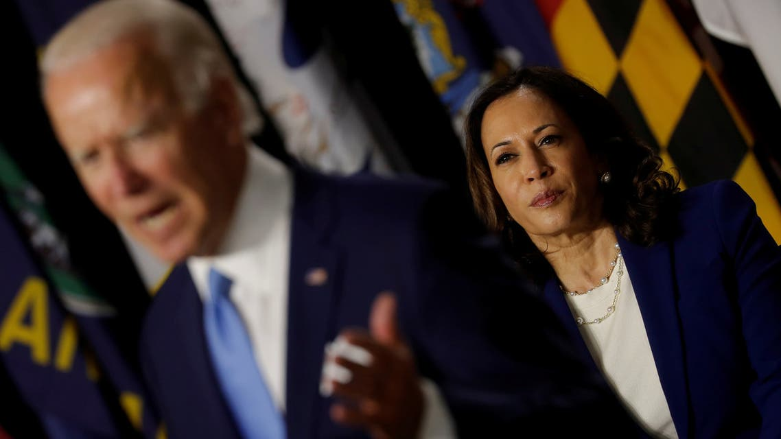 FILE PHOTO: U.S. Democratic vice presidential candidate Senator Kamala Harris listens as presidential candidate and former Vice President Joe Biden speaks at a campaign event, their first joint appearance since Biden named Harris as his running mate, at Alexis Dupont High School in Wilmington, Delaware, U.S., August 12, 2020. REUTERS/Carlos Barria/File Photo