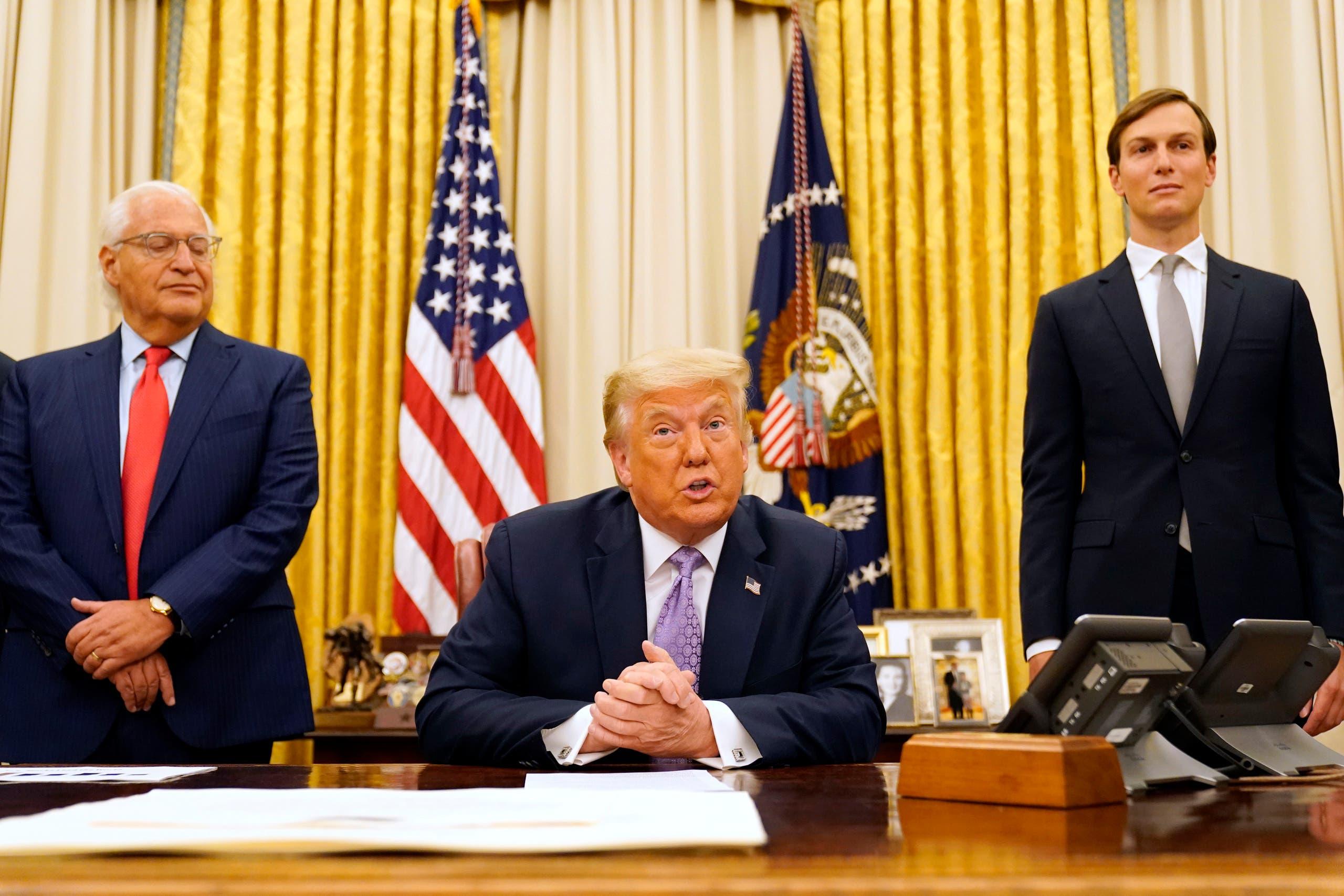 White House Senior Adviser Jared Kushner, right, as US President Donald Trump speaks in the Oval Office on Aug. 13, 2020, in Washington. (AP)
