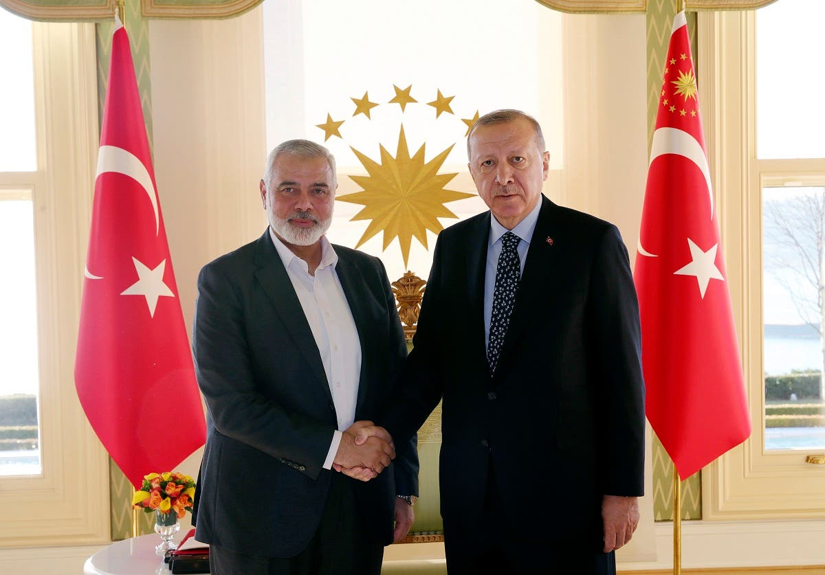 Turkey's President Recep Tayyip Erdogan, right, shakes hands with Hamas movement chief Ismail Haniyeh, prior to their meeting in Istanbul. (AP)