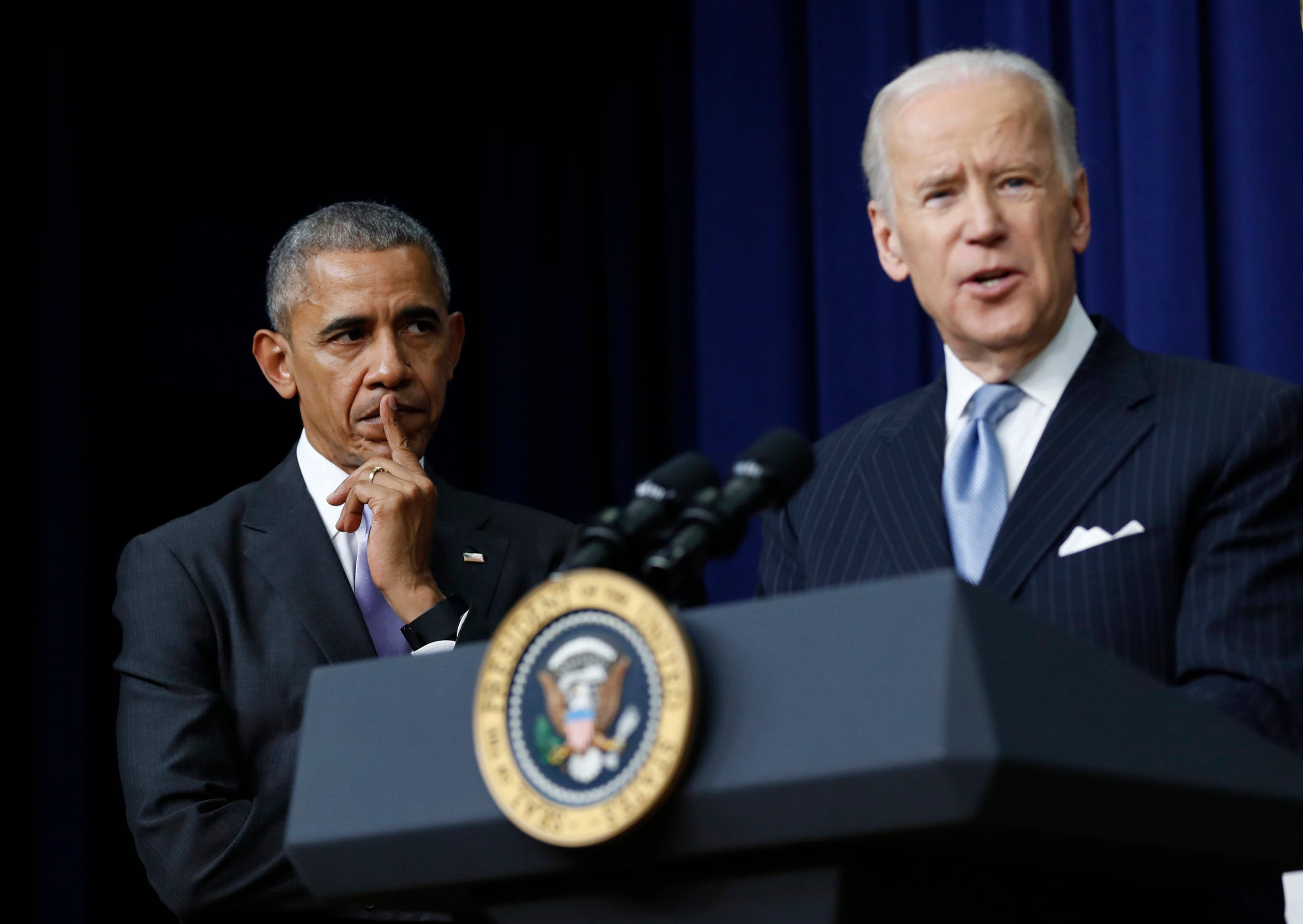 Former President Barack Obama listens as Vice President Joe Biden speaks in the South Court Auditorium in the Eisenhower Executive Office Building on the White House complex in Washington. (File photo: AP)