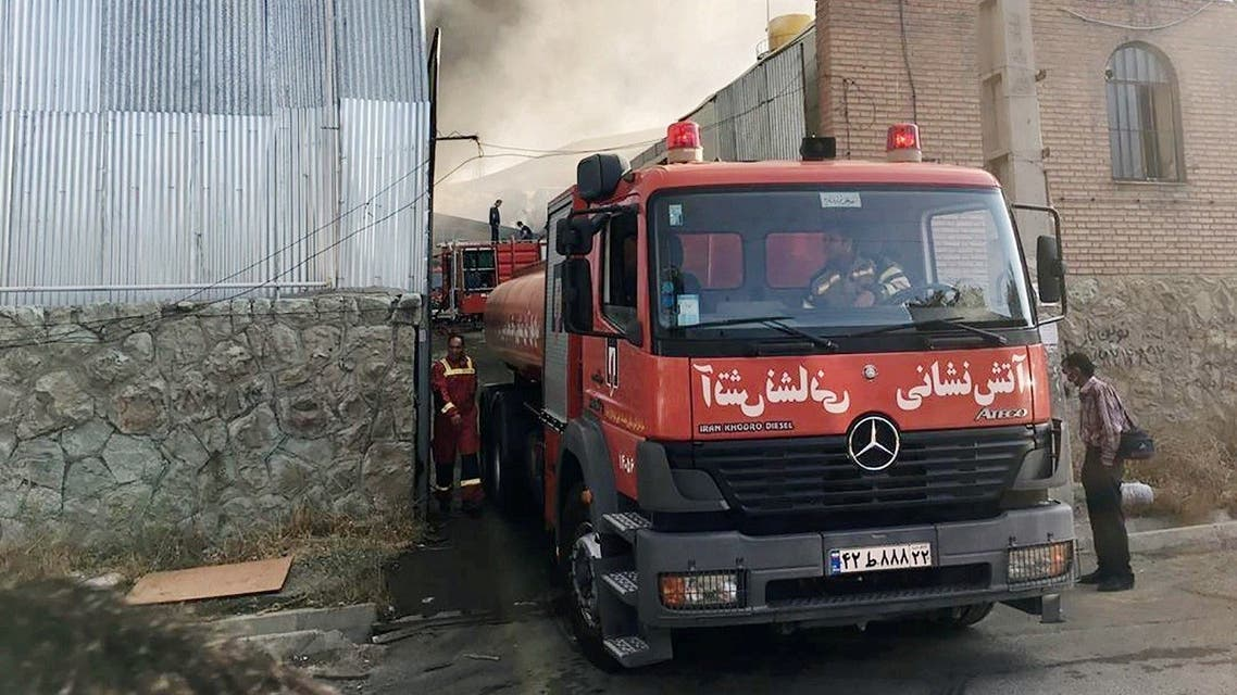 A fire engine is seen as the firefighters try to extinguish a fire that broke out at an Iranian industrial area near Tehran, Iran August 4, 2020. (West Asia News Agency/ WANA via REUTERS)