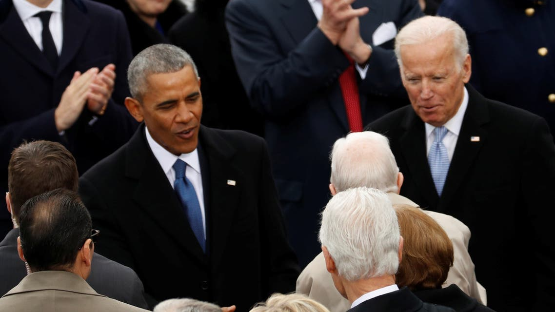 FILE PHOTO: U.S. President Barack Obama (L) and Vice President Joe Biden talk to guests at the inauguration ceremonies swearing in Donald Trump as the 45th president of the United States on the West front of the U.S. Capitol in Washington, U.S., January 20, 2017. REUTERS/Kevin Lamarque/File Photo
