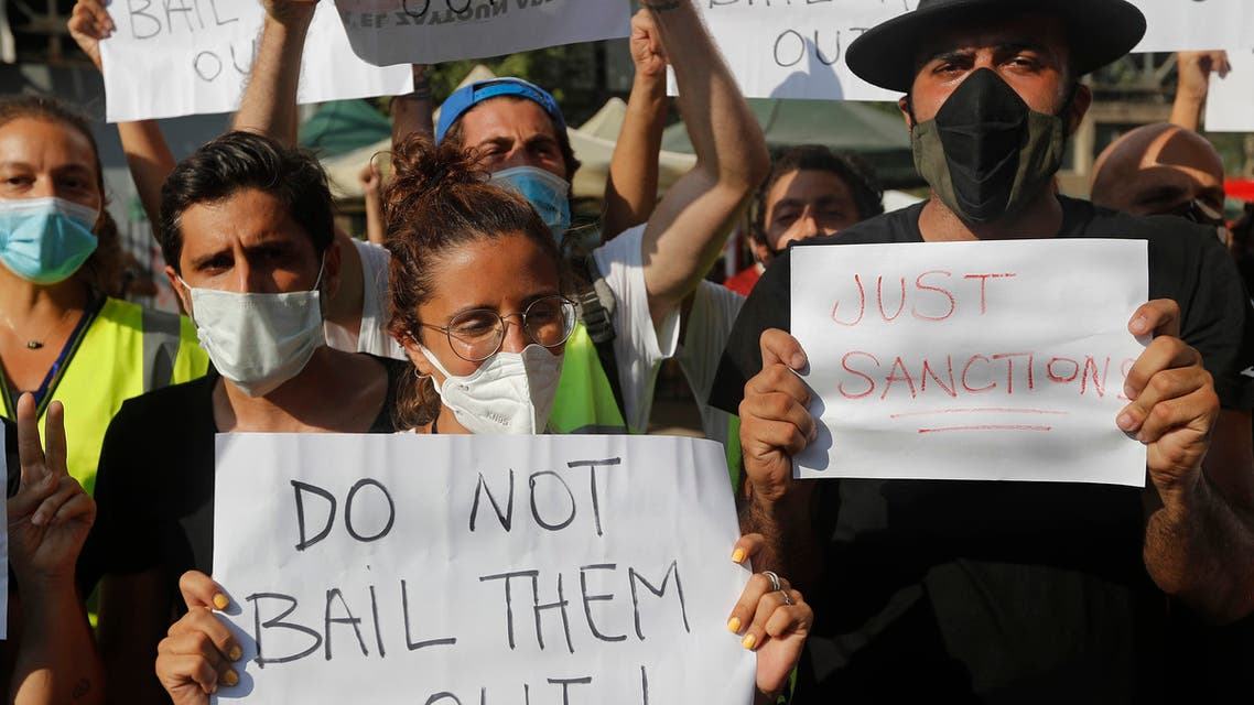 Activists in Beirut hold up placards against Lebanese politicians on Aug. 13, 2020. (AP)