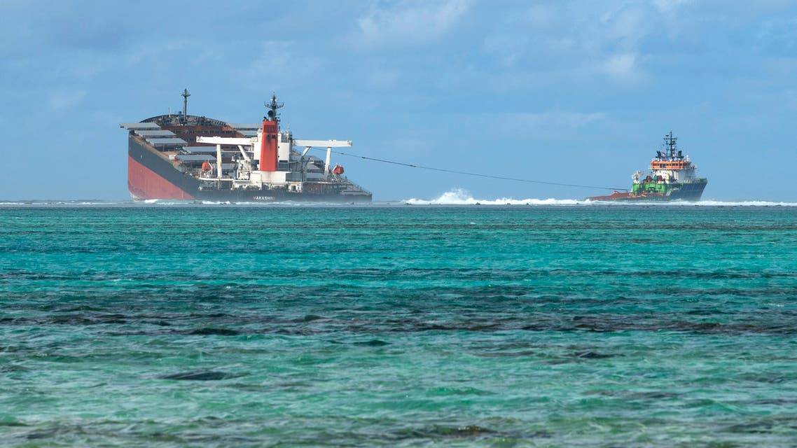 FILE PHOTO: A general view shows the bulk carrier ship MV Wakashio, that ran aground on a reef, at Riviere des Creoles, Mauritius, in this handout image obtained by Reuters on August 11, 2020. French Army command/Handout via REUTERS THIS IMAGE HAS BEEN SUPPLIED BY A THIRD PARTY./File Photo