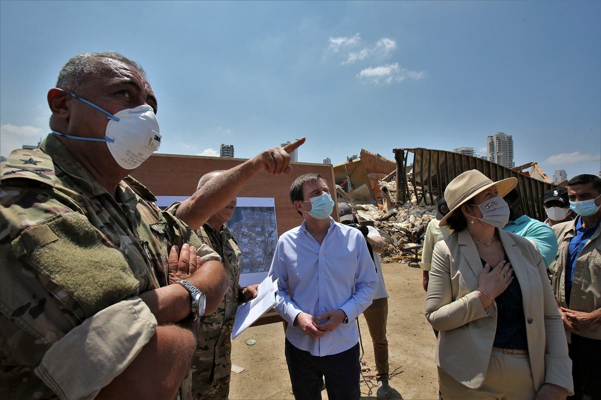 US Under Secretary of State for Political Affairs David Hale and U.S. Ambassador to Lebanon Dorothy Shea visit the site of a massive explosion at Beirut's port. (Reuters)