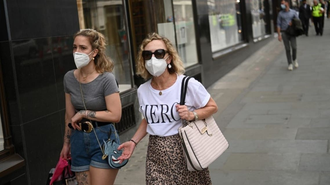 Shoppers wear face masks in central London on July 24, 2020, as lockdown restrictions continue to be eased during the novel coronavirus COVID-19 pandemic. (AFP)