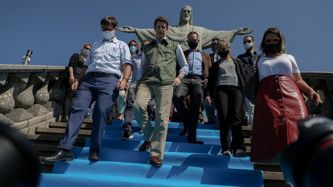 Brazilian Environment Minister Ricardo Salles (C) walks during the reopening day of touristic attractions, at the Christ The Redeemer statue, in the Corcovado Hill, Rio de Janeiro, Brazil, on August 15, 2020, amid the COVID-19 novel coronavirus pandemic. (AFP)