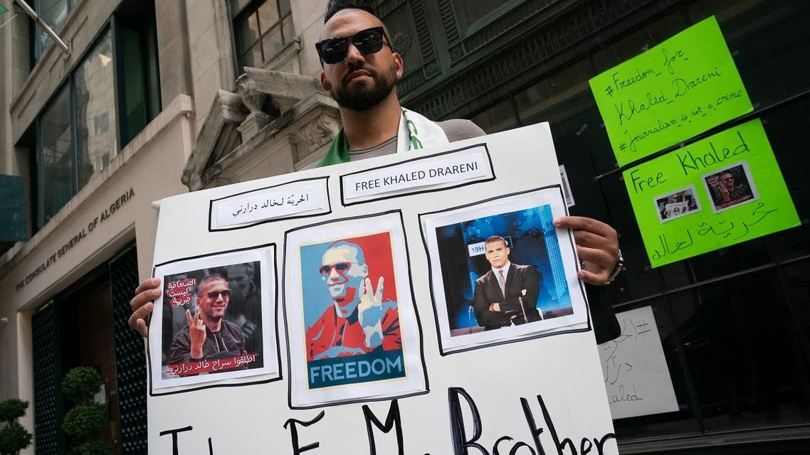 Chekib Drareni, brother of jailed Algerian journalist Khaled Drareni, protests for his brother's release outside the Algerian Consulate on August 15, 2020 in New York. (AFP)