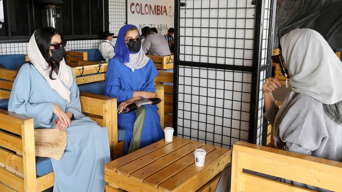 Young Saudi women sit in a cafe at Abha High City. (Reuters)