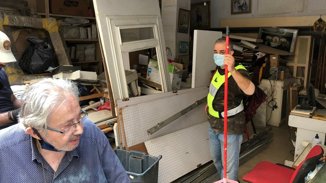Toni Shadarevian supervises maintenance workers fixing the workshop of painter Krikor Zohrab. (Sip cafe, located in a trendy Beirut neighborhood, was badly damaged in the August 4 explosion at port in Lebanon's capital. (Bassam Zaazaa)