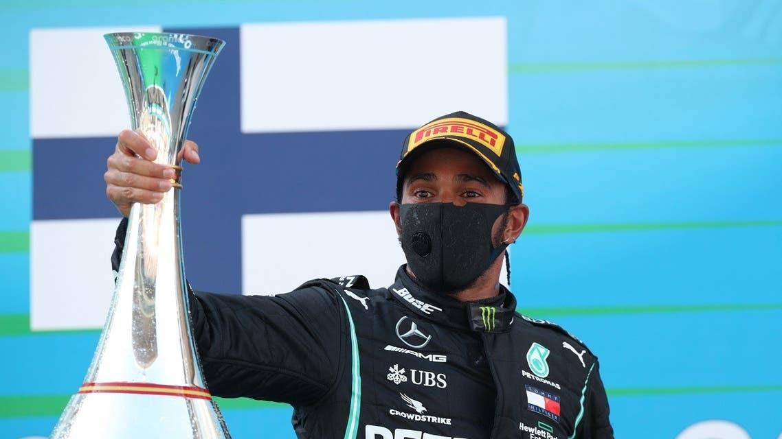 Mercedes' Lewis Hamilton celebrates on the podium after winning Formula One F1 - Spanish Grand Prix - Circuit de Barcelona-Catalunya, Barcelona, Spain, on August 16, 2020.  (Reuters)